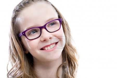 Cute girl with glasses looking at upper corner.