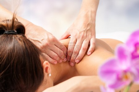 Photo for Macro close up of hands massaging female neck and shoulders - Royalty Free Image