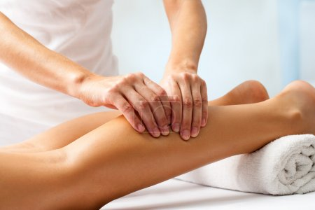 Photo for Detail of hands massaging human calf muscle.Therapist applying pressure on female leg - Royalty Free Image