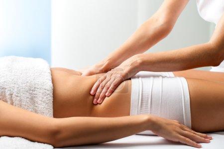 osteopath doing manipulative abdomen massage
