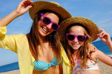 Happy girlfriends on beach