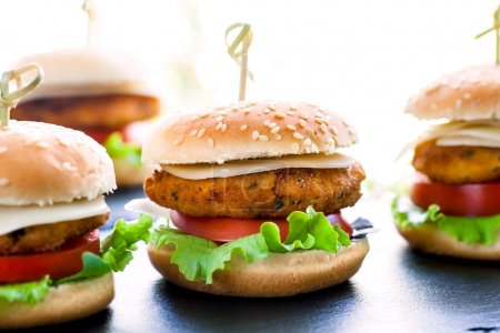 Multiple mini chicken burgers.