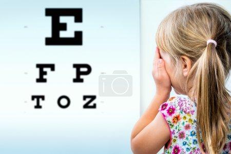 Girl testing eyesight.