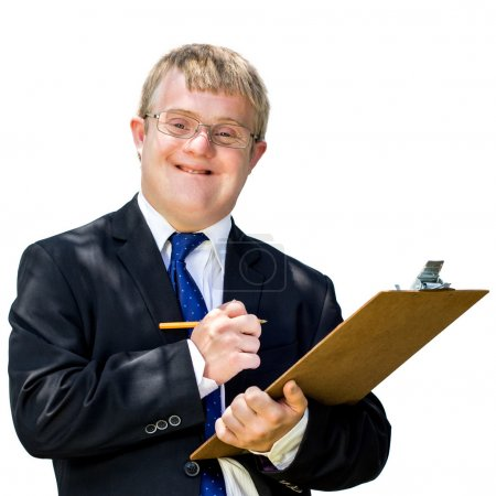 Photo for Close up portrait of young businessman with down syndrome writing on note board. Isolated against white background. - Royalty Free Image