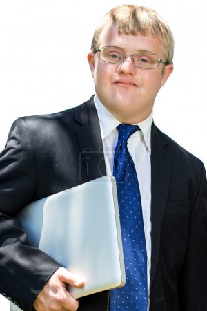 Photo for Close up portrait of Handicapped businessman with down syndrome holding laptop. Isolated on white background. - Royalty Free Image