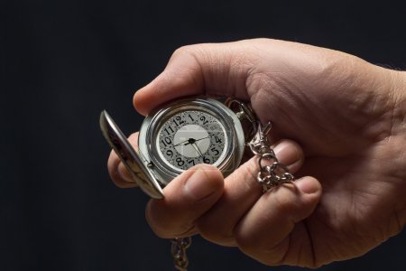 Watch with chain in  hand.