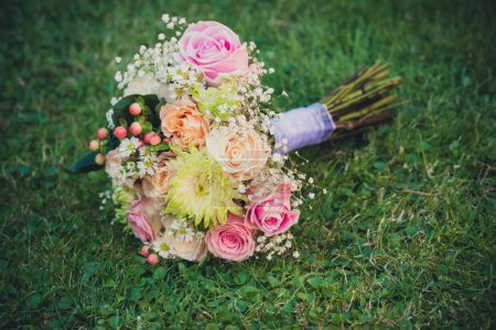 Bridal bouquet on green grass