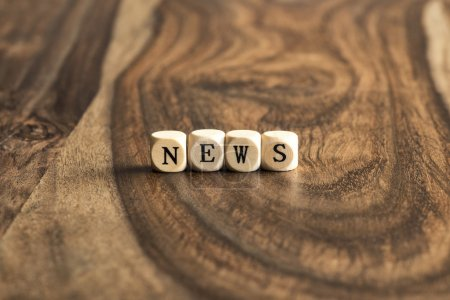 Word NEWS on wooden cubes