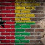 Dark brick wall texture with plaster - flag painte...