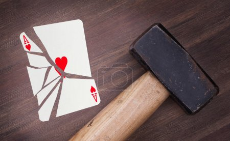 Hammer with a broken card, ace of hearts