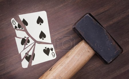 Hammer with a broken card, six of spades