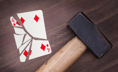 Hammer with a broken card, four of diamonds