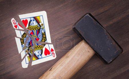 Hammer with a broken card, queen of hearts