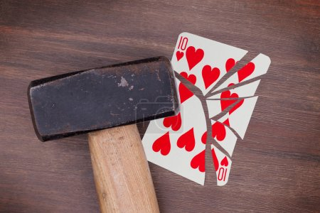 Hammer with a broken card, ten of hearts