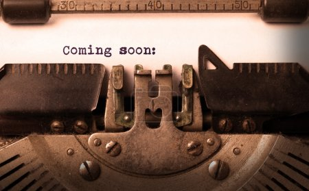 Vintage inscription made by old typewriter, coming...
