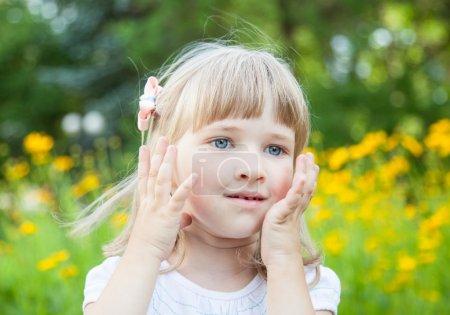 Portrait of charming little girl