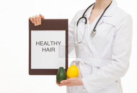 Doctor holding a clipboard and fresh fruits