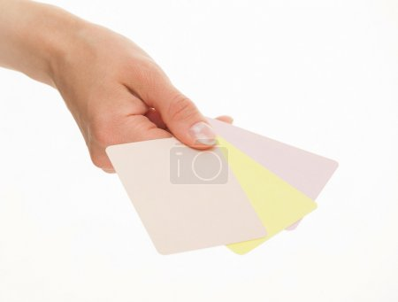 Female hand holding colorful paper cards