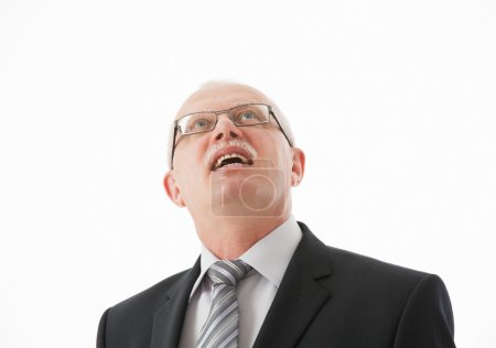 Smiling mature businessman looking  up