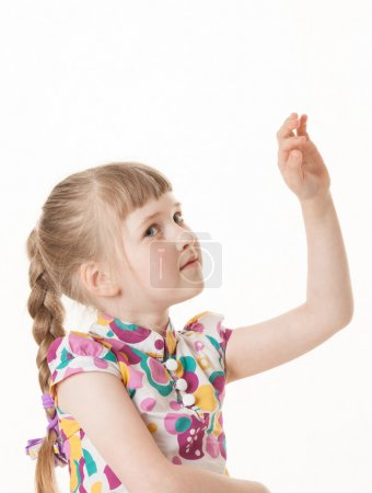 Pretty little girl showing an indefinite gesture