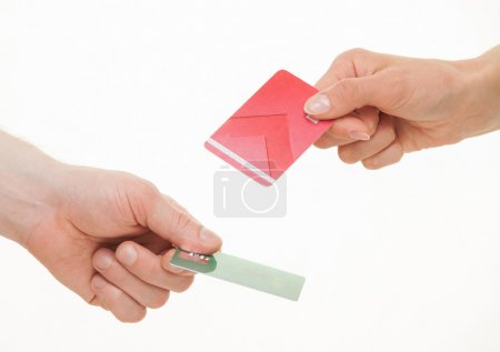 Two business people exchanging plastic cards