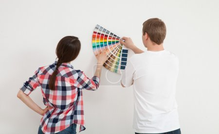Couple discussing a renovation of a home