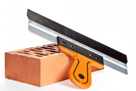 Construction putty knife and  brick