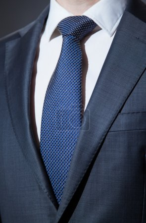 Photo for Businessman wearing formal suit and tie - closeup shot - Royalty Free Image