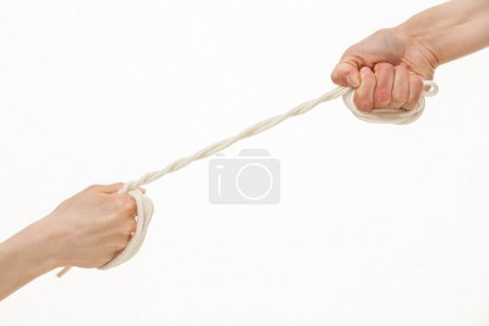 Human hands pull  string