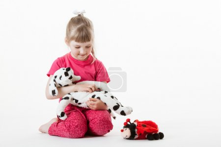Girl playing with plush toys