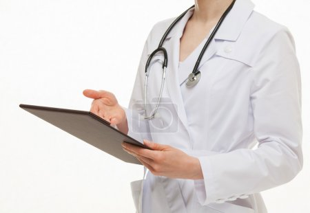 Doctor holding a folder with document