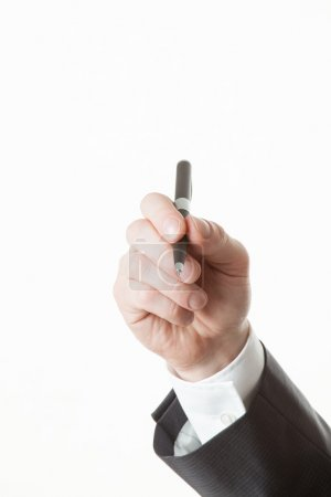 Businessman's hand holding a pen