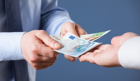 Businessman counting euro banknotes