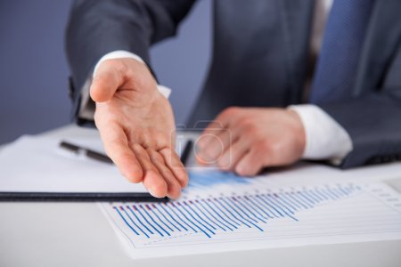 Businessman discussing financial charts