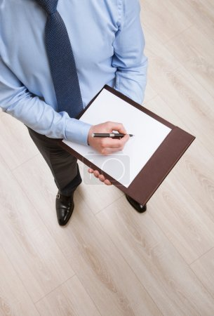 Businessman signing blank document