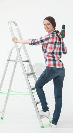 woman standing near the stepladder