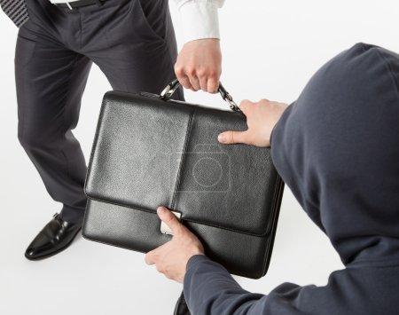 man take away a businessman's briefcase