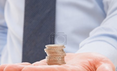 Businessman holding euro coins