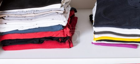 Clothes in a wardrobe close up