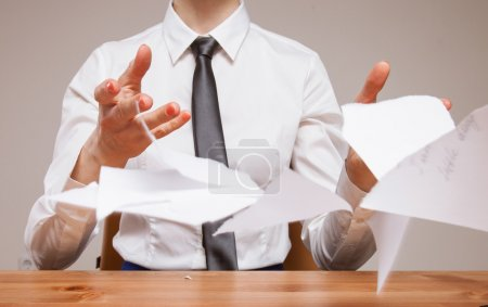 business woman throwing documents