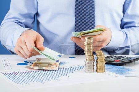 Accountants calculating profit