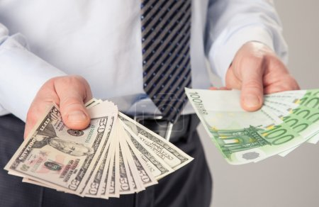 Businessman's hands giving banknotes to you