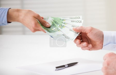 Business people transfering euro banknotes