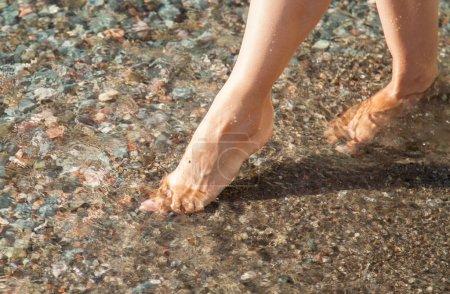 Female legs in water