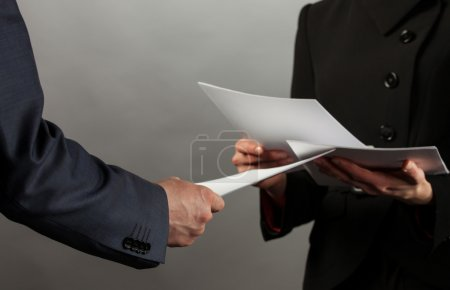 Businessmen discussing documents
