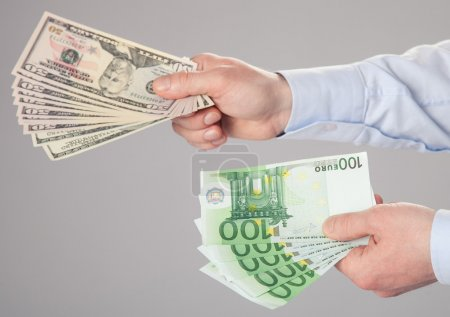 Businessman's hands reaching out banknotes