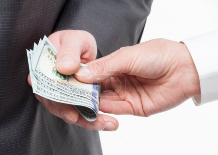 hand giving a bribe to businessman