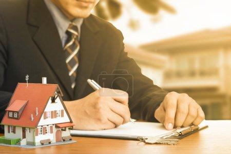 Buy house .Businessman calculate