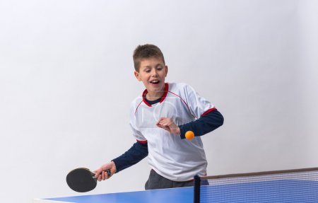 Photo for Little boy playing table tennis - Royalty Free Image