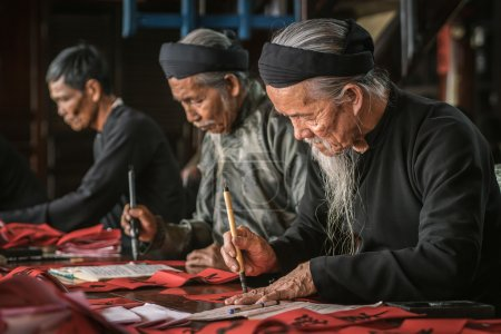 the old man with traditional black costume, white beard drawing calligraphy ancient distich in Long Son, Ba Ria Vung Tau,Vietnam to celebrating lunar new year coming.